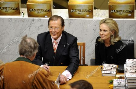 Stock Image of Sir Roger Moore with his wife Christina Tholstrup.