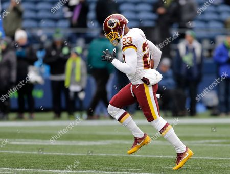 Washington Redskins free safety DeAngelo Hall (23) warms up before an NFL football game against the Seattle Seahawks, in Seattle