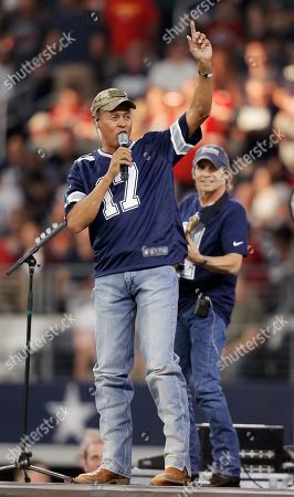Country music signer Neal McCoy performs during a Salute to Service halftime show during an NFL football game between the Kansas City Chiefs and Dallas Cowboys, in Arlington, Texas. The NFL honored military members around the league with their Salute to Service campaign