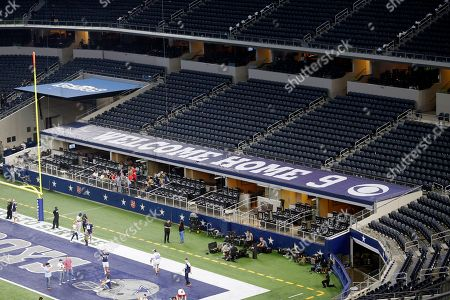 A welcome message is seen on a section of suites roofing intended for broadcast analyst Tony Romo after an NFL football game against the Kansas City Chiefs, in Arlington, Texas. Romo, who quarterbacked the team for 11 years, was celebrated in a pregame ceremony