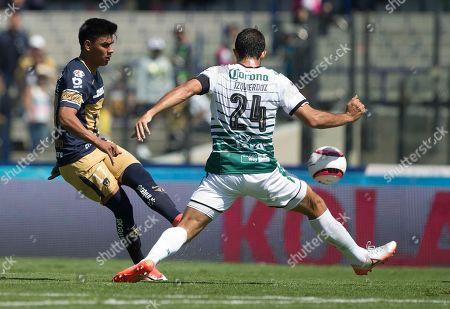 Jesus Gallardo, Carlos Izquierdoz. Pumas' Jesus Gallardo, left, competes for the ball with Santos' Carlos Izquierdoz during a Mexico soccer league match, in Mexico City