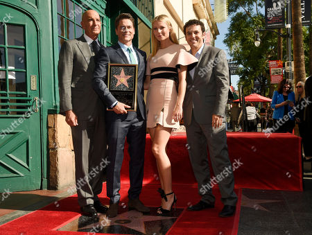 Actor Rob Lowe, second from left, poses with, left to right, Miramax Chairman Tom Barrack, actress Gwyneth Paltrow and actor Fred Savage after receiving a star on the Hollywood Walk of Fame, in Los Angeles