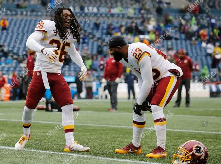 Washington Redskins free safety DeAngelo Hall, right, is greeted by free safety D.J. Swearinger, left, during warmups before an NFL football game against the Seattle Seahawks, in Seattle