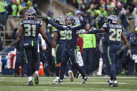 Seattle Seahawks defensive end Jarran Reed (90) celebrates a defensive stop with Seattle Seahawks cornerback Justin Coleman (28) and Seattle Seahawks safety Kam Chancellor (31) during a game between the Washington Redskins and the Seattle Seahawks at CenturyLink Field in Seattle, WA on , 2017. The Redskins defeated the Seahawks 17-14