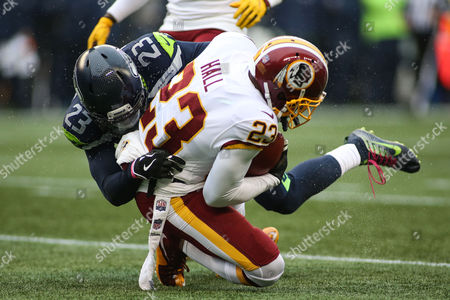 Seattle Seahawks cornerback Neiko Thorpe (23) hits Washington Redskins safety DeAngelo Hall (23) during a game between the Washington Redskins and the Seattle Seahawks at CenturyLink Field in Seattle, WA on , 2017. The Redskins defeated the Seahawks 17-14