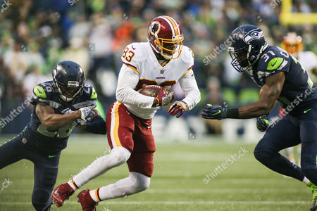 Seattle Seahawks safety Kam Chancellor (31) and Seattle Seahawks cornerback Shaquill Gtiffin (26) go in to tackle Washington Redskins wide receiver Brian Quick (83) csm