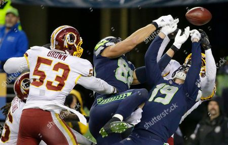 Stock Picture of Washington Redskins free safety DeAngelo Hall, right obscured, and inside linebacker Zach Brown (53) break up a pass as Seattle Seahawks tight end Jimmy Graham (88) and wide receiver Tanner McEvoy (19) reach for the ball late in the second half of an NFL football game, in Seattle. Washington won 17-14
