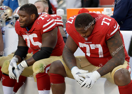 Laken Tomlinson, Trent Brown. San Francisco 49ers offensive guard Laken Tomlinson (75) and offensive tackle Trent Brown (77) sit on the bench during the second half of an NFL football game against the Arizona Cardinals in Santa Clara, Calif