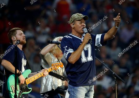 Entertainer Neal McCoy performs at half time of an NFL football game between the Kansas City Chiefs and Dallas Cowboys, in Arlington, Texas. McCoy performance was part of the NFL's Salute To Service campaign