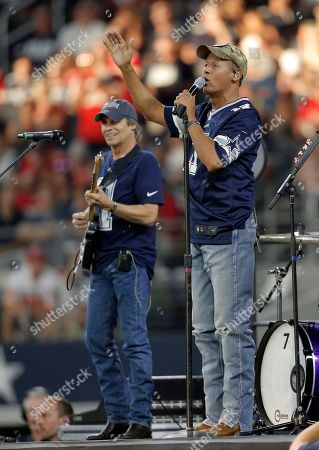 Entertainer Neal McCoy sings during a Salute To Service halftime performance of an NFL football game between the Kansas City Chiefs and Dallas Cowboys, in Arlington, Texas