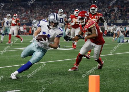Cole Beasley, Steven Nelson. Kansas City Chiefs' Alex Smith (11) sprints to the end zone for a touchdown as Kansas City Chiefs' Steven Nelson (20) gives chase in the second half of an NFL football game, in Arlington, Texas