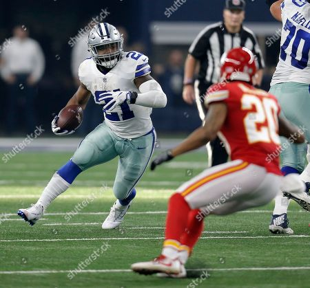 Ezekiel Elliott, Steven Nelson. Dallas Cowboys' Ezekiel Elliott (21) looks for running room as Kansas City Chiefs' Steven Nelson (20) gives chase in the first half of an NFL football game, in Arlington, Texas