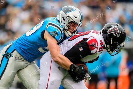 Carolina Panthers linebacker Luke Kuechly (59) and Atlanta Falcons fullback Derrick Coleman (40) during the NFL football game between the Atlanta Falcons and the Carolina Panthers on in Charlotte, NC