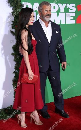 """Rosalind Ross, Mel Gibson. Rosalind Ross, left, and Mel Gibson arrive at the LA Premiere of """"Daddy's Home 2"""" at the Regency Village Theatre, in Los Angeles"""