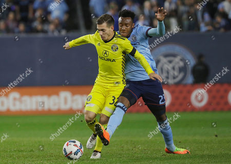 Columbus Crew's Pedro Santos (32) is defended by New York City FC's Rodney Wallace (23) during the first half of an MLS Eastern Conference semifinal soccer match, in New York