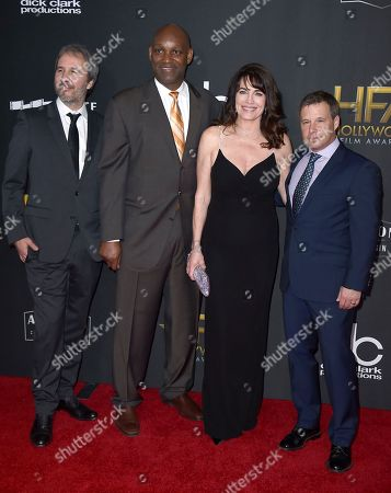 Stock Image of Denis Villeneuve, Broderick Johnson, Cynthia Sikes, Andrew Kosove. Denis Villeneuve, from left, Broderick Johnson, Cynthia Sikes, and Andrew Kosove arrive at the Hollywood Film Awards at the Beverly Hilton hotel, in Beverly Hills, Calif