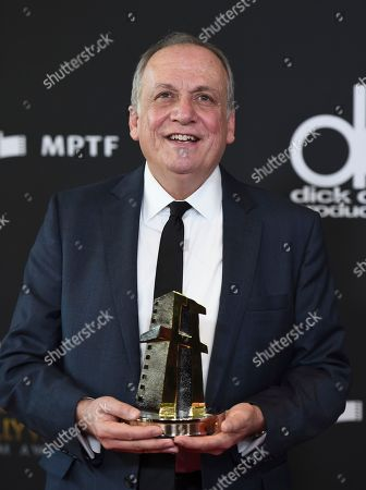 """Stock Image of Joe Letteri poses with the """"Hollywood visual effects award"""" for """"War for the Planet of the Apes"""" at the Hollywood Film Awards at the Beverly Hilton hotel, in Beverly Hills, Calif"""