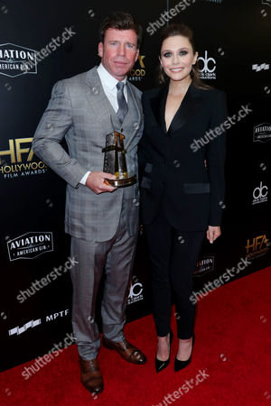 Taylor Sheridan and Elizabeth Olsen