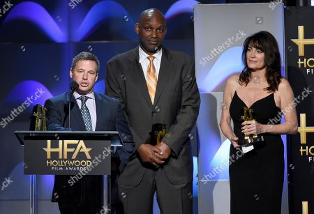 """Stock Image of Andrew Kosove, Broderick Johnson, Cynthia Yorkin. Andrew Kosove, from left, Broderick Johnson, and Cynthia Yorkin accept the Hollywood producer award for """"Blade Runner 2049"""" at the Hollywood Film Awards at the Beverly Hilton hotel, in Beverly Hills, Calif"""
