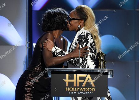"""Viola Davis, Mary J Blige. Viola Davis, left, presents Mary J Blige the Hollywood breakout performance actress award for """"Mudbound"""" at the Hollywood breakout performance actress award at the Hollywood Film Awards at the Beverly Hilton hotel, in Beverly Hills, Calif"""