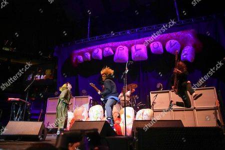Hannah Hooper, Christian Zucconi, Ryan Rabin, Sean Gadd. Singer/keyboardist Hannah Hooper, from left, guitarist/singer Christian Zucconi, drummer Ryan Rabin and bassist Sean Gadd, of Grouplove, perform on stage at the Capitol One Arena, in Washington