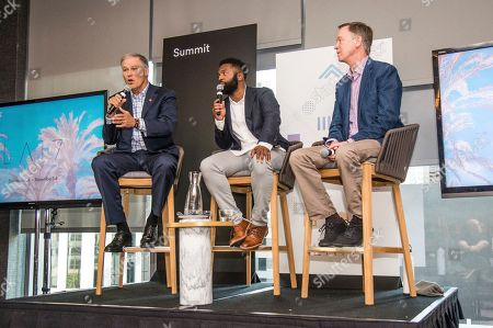 Stock Image of Jay Inslee, Baratunde Thurston, John Hickenlooper. Jay Inslee, from left, Baratunde Thurston and John Hickenlooper seen on day two of Summit LA17 in Downtown Los Angeles's Historic Broadway Theater District, in Los Angeles