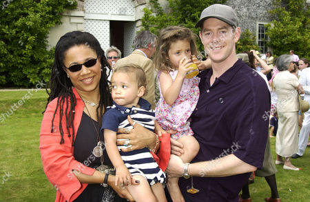 Nimmy March with her husband Gavin Burke and children Khaya and Malachy