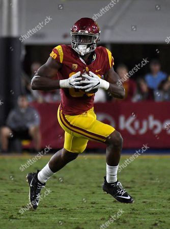 Southern California tight end Daniel Imatorbhebhe runs the ball during the first half of an NCAA college football game against Arizona, in Los Angeles