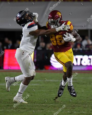 Daniel Imatorbhebhe, Tony Fields. Southern California tight end Daniel Imatorbhebhe, right, stiff-arms Arizona linebacker Tony Fields II during the first half of an NCAA college football game, in Los Angeles