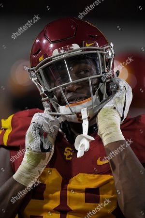 Southern California tight end Daniel Imatorbhebhe takes his helmet off during the second half of an NCAA college football game against Arizona, in Los Angeles. USC won 49-35