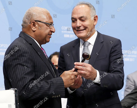 President of the COP22/CMP12, former Moroccan foreign minister Salaheddine Mezouar (R) gives the hammer to Fiji's Prime Minister Frank Bainimarama (L) President of COP23/CMP13, during the UN Climate Change Conference COP23 in Bonn, Germany, 06 November 2017. The 23rd session of the United Nations Framework Convention on Climate Change Conference (UNFCCC), the 2017 UN Climate Change Conference COP23 will take place from 06 to 17 November in Bonn, the seat of the Climate Change Secretariat, under the presidency of Fiji.
