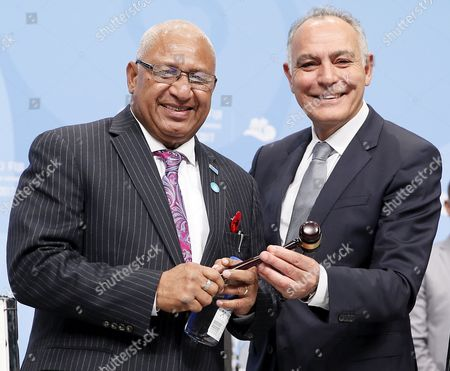 Stock Picture of President of the COP22/CMP12, former Moroccan foreign minister Salaheddine Mezouar (R) gives the hammer to Fiji's Prime Minister Frank Bainimarama (L) President of COP23/CMP13, during the UN Climate Change Conference COP23 in Bonn, Germany, 06 November 2017. The 23rd session of the United Nations Framework Convention on Climate Change Conference (UNFCCC), the 2017 UN Climate Change Conference COP23 will take place from 06 to 17 November in Bonn, the seat of the Climate Change Secretariat, under the presidency of Fiji.
