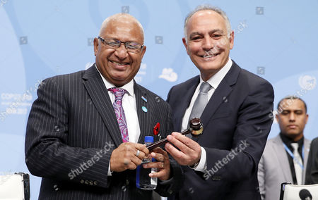 Stock Image of President of the COP22/CMP12, former Moroccan foreign minister Salaheddine Mezouar (R) gives the hammer to Fiji's Prime Minister Frank Bainimarama (L) President of COP23/CMP13, during the UN Climate Change Conference COP23 in Bonn, Germany, 06 November 2017. The 23rd session of the United Nations Framework Convention on Climate Change Conference (UNFCCC), the 2017 UN Climate Change Conference COP23 will take place from 06 to 17 November in Bonn, the seat of the Climate Change Secretariat, under the presidency of Fiji.