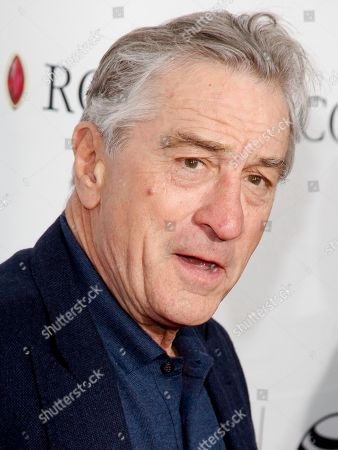 "Robert De Niro attends a Tribeca Film Festival closing night special screening of ""Goodfellas"" at the Beacon Theater in New York. De Niro stars as trainer Ray Arcel in the film, ""Hands of Stone,"" a film about boxing legend Roberto Duran. The film was picked up by The Weinstein Company for U.S. distribution rights during the Cannes International Film Festival"