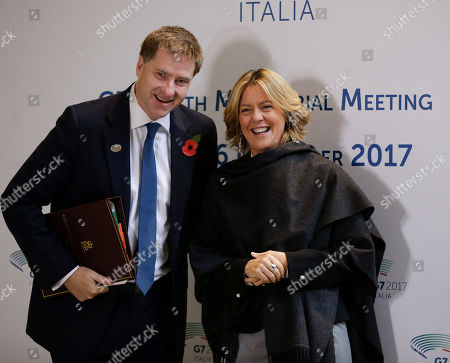 Stock Image of Italy's Minister of Health Beatrice Lorenzin, right, meets United Kingdom's Undersecretary for Public Health and Community Heath Steve Brine at the G7 Health Ministerial Meeting in Milan, Italy
