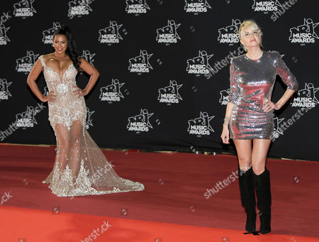 """Hollysiz, Ayem Nour. French actress Cecile Cassel known as singer """"Hollysiz"""", right, and television host Ayem Nour pose during a photocall before the NRJ Music awards ceremony, in Cannes, southeastern France"""