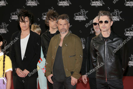 Nicola Sirkis, Marco, Boris Jardel, oLi dE SaT, Ludwig Dahlberg, Indochine. Left to right, Nicola Sirkis, Ludwig Dahlberg, oLi dE SaT, Marco, Boris Jardel of the French Pop Rock group Indochine pose during a photocall before the NRJ Music awards ceremony, in Cannes, southeastern France