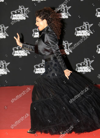 Belgian humorist Nawell Madani poses during a photocall before the NRJ Music awards ceremony, in Cannes, southeastern France