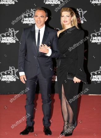 Nikos Aliagas and Tina Grigoriou. French-Greek television host Nikos Aliagas and partner Tina Grigoriou pose during a photocall prior to the NRJ Music awards ceremony, in Cannes, southeastern France
