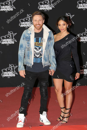 David Guetta, Jessica Ledon. French DJ and producer of electro music, David Guetta, left, poses with his partner Jessica Ledon at the Cannes festival palace during the NRJ Music awards ceremony, in Cannes, southeastern France