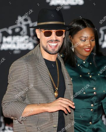 """Youssef Akdim """"Lartiste'"""", Awa Imani. French singers Youssef Akdim """"Lartiste'"""", left, and Awa Imani arrive at the Cannes festival palace, to take part in the NRJ Music awards ceremony, in Cannes, southeastern France"""