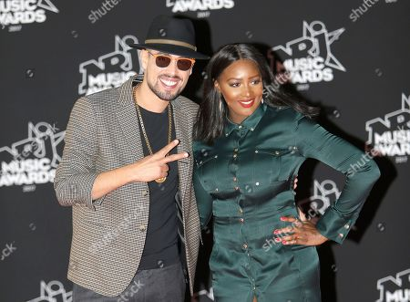 """Stock Picture of Youssef Akdim """"Lartiste'"""", Awa Imani. French singers Youssef Akdim """"Lartiste'"""", left, and Awa Imani arrive at the Cannes festival palace, to take part in the NRJ Music awards ceremony, in Cannes, southeastern France"""