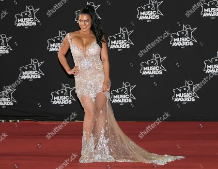 French television host Ayem Nour pose during a photocall at the Cannes festival palace before the NRJ Music awards ceremony, in Cannes, southeastern France