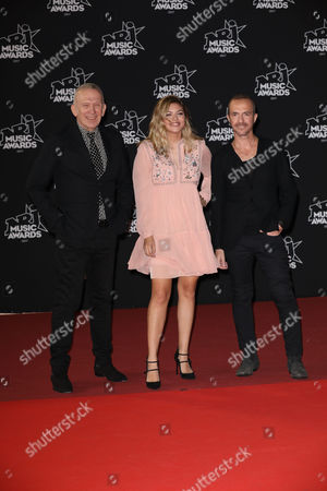 (L-R) Designer Jean Paul Gaultier, singer Louane Emera and Calogero Maurici attend the 19th 'NRJ Music Awards' ceremony on November 4, 2017 in Cannes, France