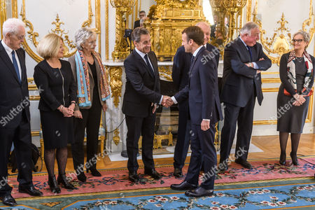 French President Emmanuel Macron (3-R) shakes hand with Former president Nicolas Sarkozy (4-L) prior to his speech to the Constitutional Council members, former prime minister Lionel Jospin (L),  Nicole Maestracci (2-L), Claire Bazy-Malaurie (3-L), Senat president Gerard Larcher (2-R), newly named member of the Council Dominique Lottin (R) during her oath-taking ceremony at the Elysee Palace in Paris, France, 06 November 2017. Dominique Lottin replaces Nicole Belloubet who became Justice Minister in June.