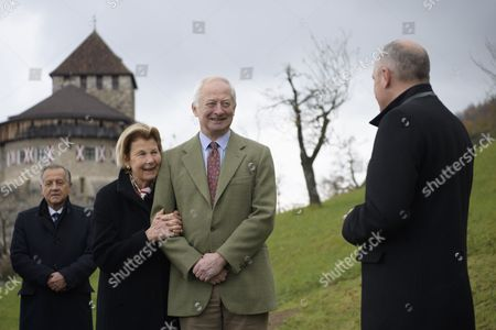 Stock Image of (L-R) Landtag president Albert Frick, H.S.H. Princess Marie of Liechtenstein, H.S.H. Prince Hans-Adam II of Liechtenstein and prime minister Adrian Hasler, react  before the delivery of a tree that was given as a gift to Prince Hans-Adam II and Princess Marie for their Golden Wedding by the government of Liechtenstein in Vaduz, Liechtenstein, 06 November 2017.