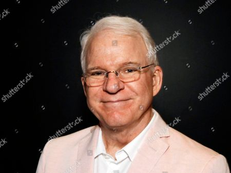 """Steve Martin poses during """"The Un-Private Collection: Eric Fischl and Steve Martin,"""" an art talk presented by The Broad museum in Santa Monica, Calif. Martin will receive the American Film Instituteâ?™s 43th Life Achievement Award at a private ceremony on June 4, 2015, in Hollywood"""