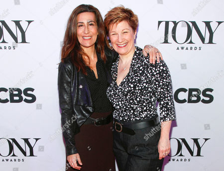 "Jeanine Tesori, left, and Lisa Kron, from ""Fun Home,"" attend the 2015 Tony Awards Meet the Nominees press junket in New York. Tesori and Kron can make history when the Tony awards are announced on . If they win, the pair will become the first female writing team to nab a Tony for best musical score"