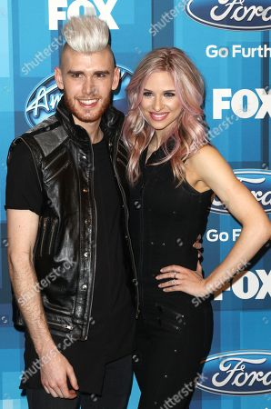 """Colton Dixon, left, and Annie Coggeshall arrive at the """"American Idol"""" farewell season finale at the Dolby Theatre, in Los Angeles"""
