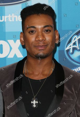 """Joshua Ledet arrives at the """"American Idol"""" farewell season finale at the Dolby Theatre, in Los Angeles"""